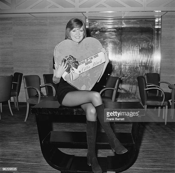 English singer Cilla Black at the Savoy Hotel London with a special presentation box of chocolates her award after being chosen as the Mothers' Day...