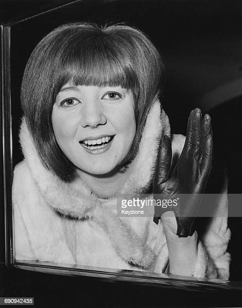 English singer Cilla Black leaves her London hotel for a holiday in the Canary Islands 18th December 1964
