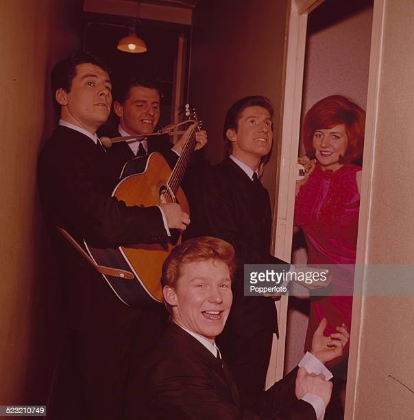 English singer Cilla Black pictured with members of Merseybeat group The Searchers backstage during a recording of the television music series 'Thank...