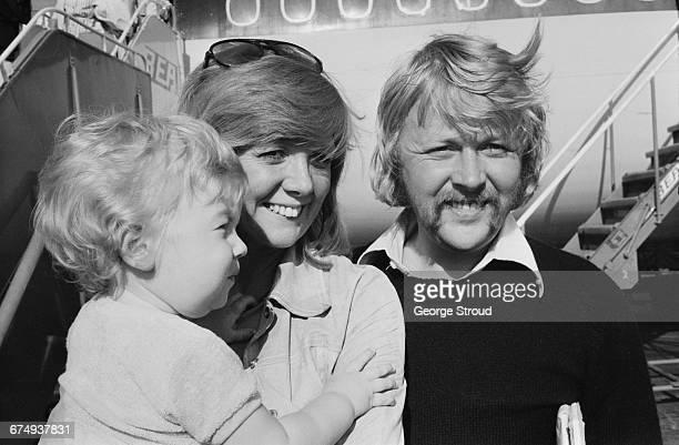 English singer Cilla Black returns from holiday with her husband Bobby Willis and son Robert UK 7th September 1971