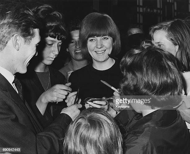 English singer Cilla Black surrounded by fans at the London Palladium UK 17th August 1964 She had briefly been replaced by Jackie Trent whilst...