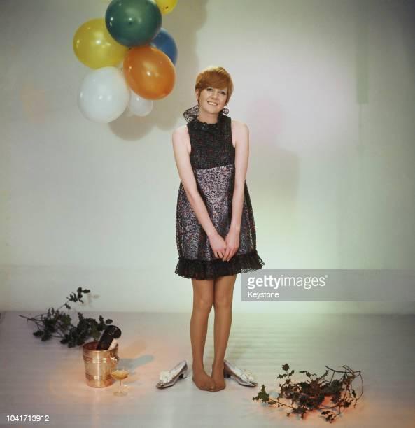 English singer Cilla Black with balloons and holly, circa 1965.