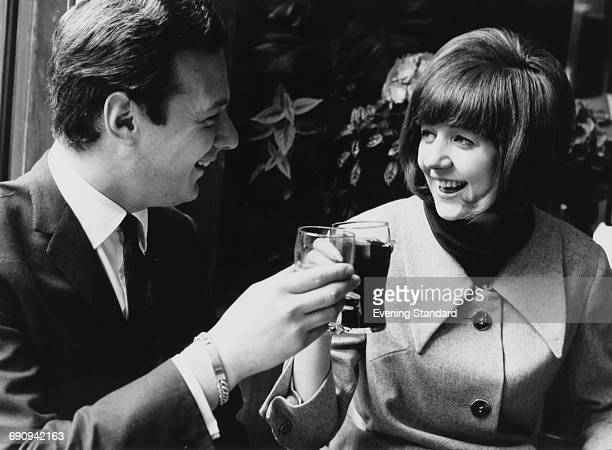English singer Cilla Black with her manager Brian Epstein , UK, 1964.