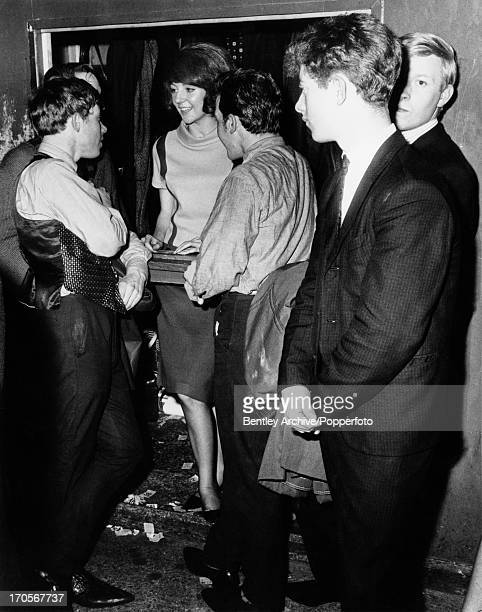 English singer Cilla Black working at her parttime job as cloakroom attendant at The Cavern Club Liverpool 4th January 1964