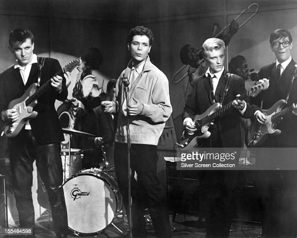 English singer Cliff Richard performing with The Shadows in 'Expresso Bongo' directed by Val Guest 1959 Left to right Bruce Welch Cliff Richard Jet...