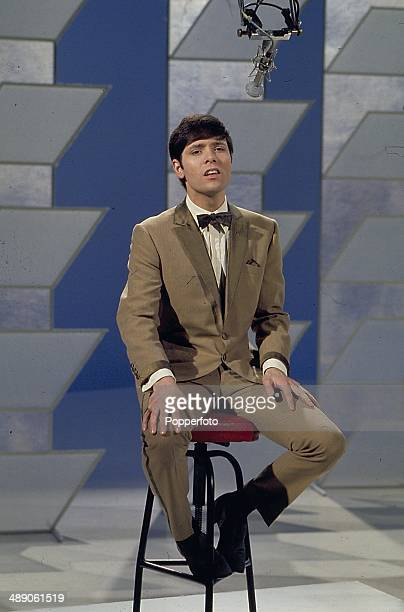 1968 English singer Cliff Richard performs on the Morecambe and Wise television show in 1968