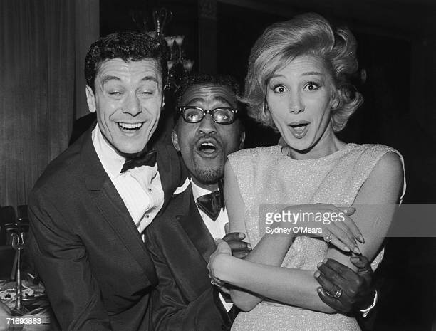 English singer dancer and actress Joyce Blair with her brother Lionel and American entertainer Sammy Davis Jr at the Dorchester Hotel London 14th...