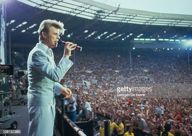 English singer David Bowie performing at the Live Aid concert at Wembley Stadium in London, 13th July 1985. The concert raised funds for famine...
