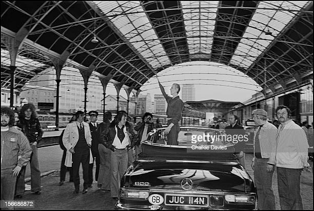 English singer David Bowie standing in a Mercedes convertible at Victoria Station London during his 'Station To Station' tour 2nd May 1976 Bowie's...