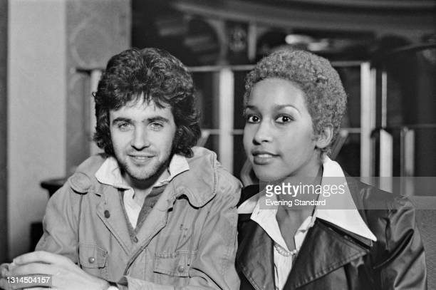 English singer David Essex and American actress, model and singer Marsha Hunt recording the soundtrack for the rock musical 'Tommy', by English rock...