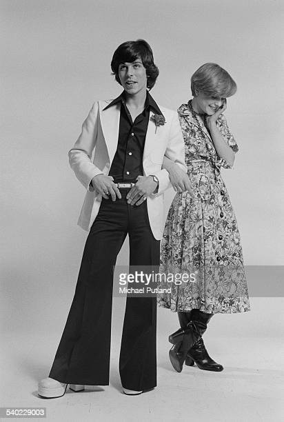 English singer David Van Day of pop group Guys 'n' Dolls and a young woman modelling fashionable outfits 24th March 1975