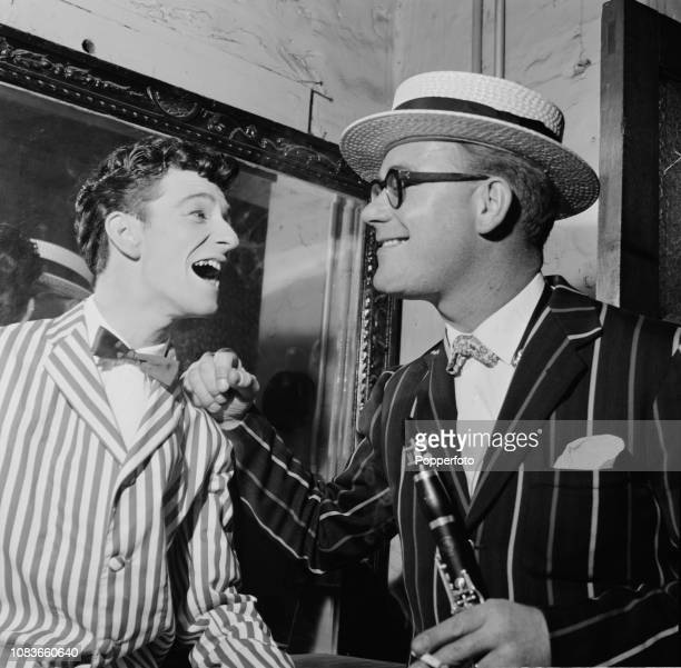 English singer Dickie Pride pictured on left with clarinet player Red Price backstage at a venue during a 'Rock n' Trad' touring show date in October...