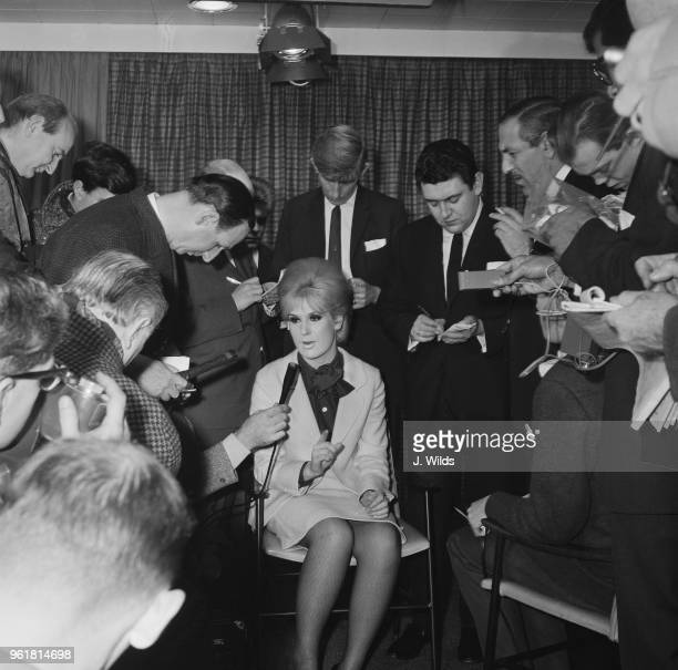 English singer Dusty Springfield is interviewed by the press at London Airport after being deported from South Africa 18th December 1964 She and her...
