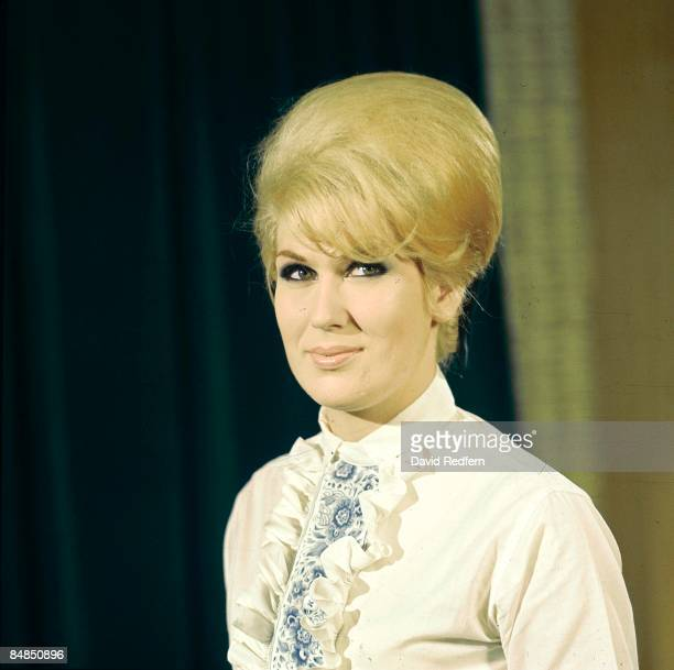 English singer Dusty Springfield , posed on the set of a television show circa 1965.