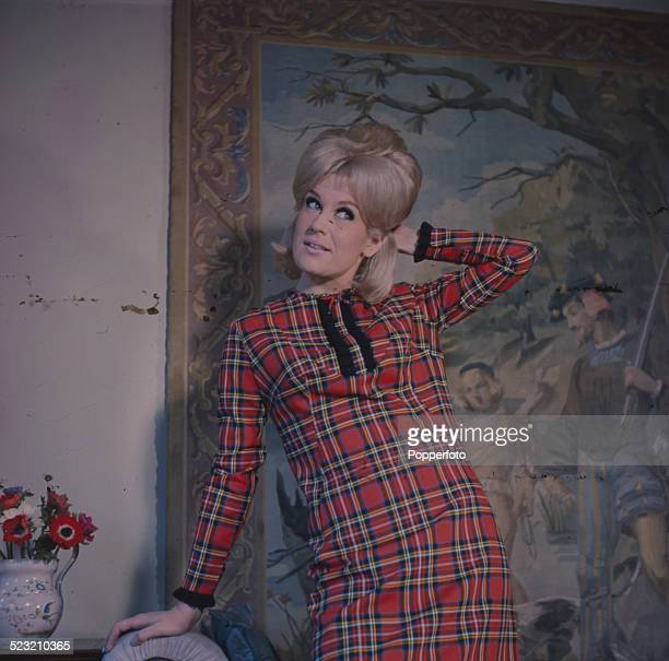 English singer Dusty Springfield posed wearing a tartan pattern dress in 1963