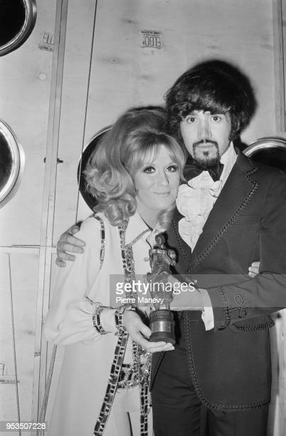 English singer Dusty Springfield with English author songwriter and composer Tony Macaulay who won 'Songwriter of the Year' award UK 11th May 1970