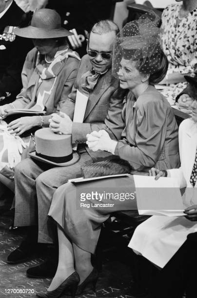English singer Elton John and his wife Renate at the royal wedding of Prince Andrew and Sarah Ferguson at Westminster Abbey in London, 23rd July 1986.