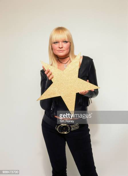 English singer Emma Bunton aka 'Baby Spice' formerly of girl group The Spice Girls holding a a cardboard star circa 2000
