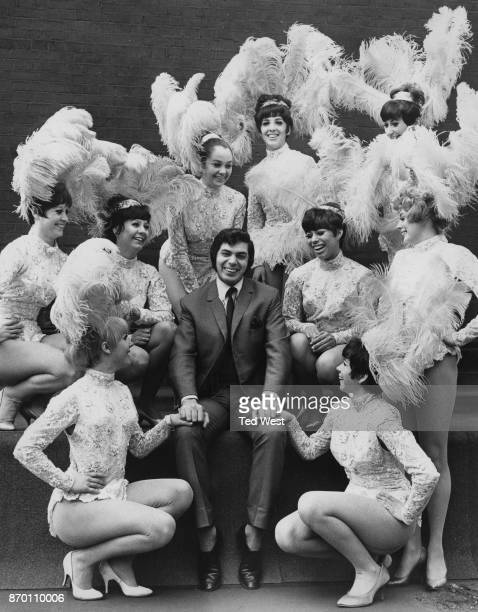 English singer Engelbert Humperdinck with nine female performers from his show 'Robinson Crusoe' at the London Palladium UK 8th April 1968 They will...