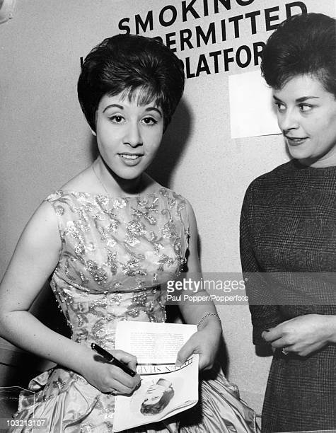 English singer Helen Shapiro signs autographs after a show at the Royal Albert Hall in London 20th September 1961