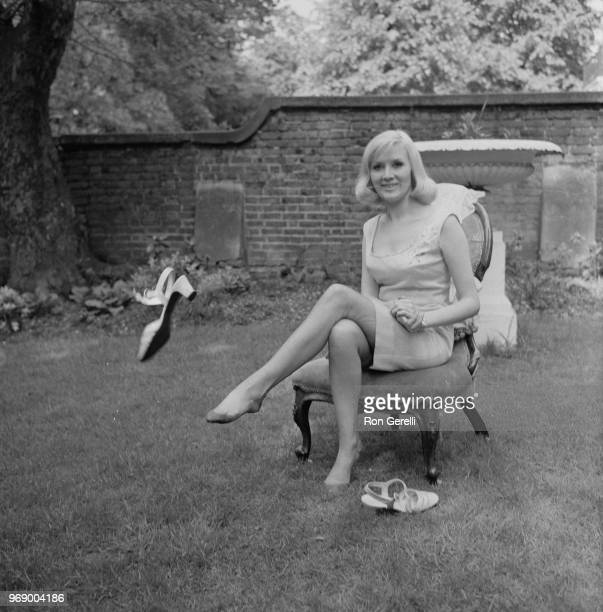 English singer Janie Jones takes out her shoes while sitting on a chair in a back garden after acquittal of vice and controlled prostitution charges,...