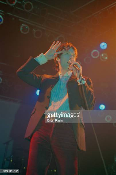 English singer Jarvis Cocker sings live on stage with Pulp at the Forum in London on 6th May 1994