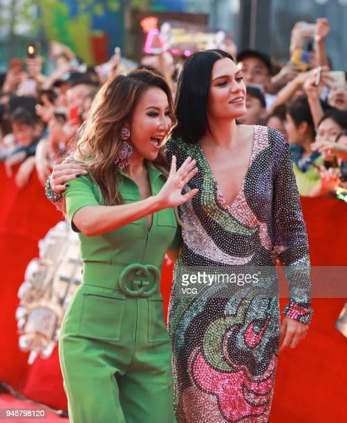 English singer Jessie J and singer CoCo Lee arrive at the red carpet one day before the finals of music talent show 'Singer' on April 12 2018 in...