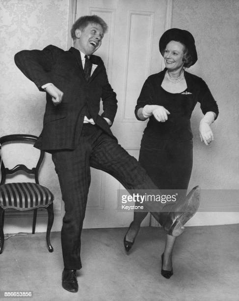 English singer Joe Brown dancing with actress Anna Neagle his costar in the upcoming stage musical 'Charlie Girl' in a West End office London 11th...