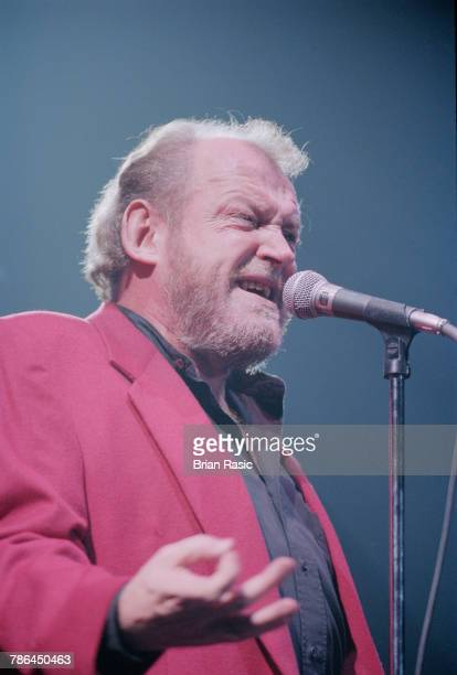 English singer Joe Cocker performs live on stage at Wembley Arena in London on 4th December 1994