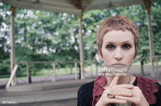 English singer Julie Driscoll pictured standing in front of a band stand in Hyde Park London in 1968