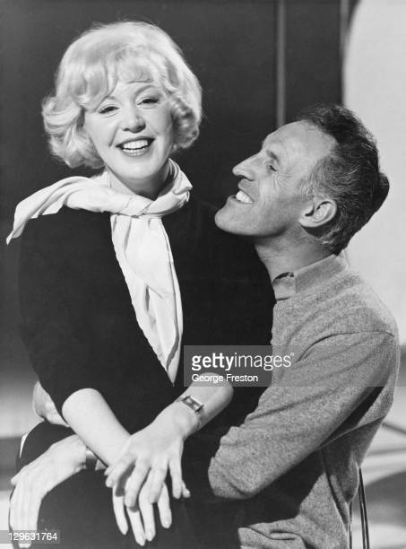 English singer Kathy Kirby rehearses for her guest appearance with British television personality Bruce Forsyth at the ABC Television Studios in...