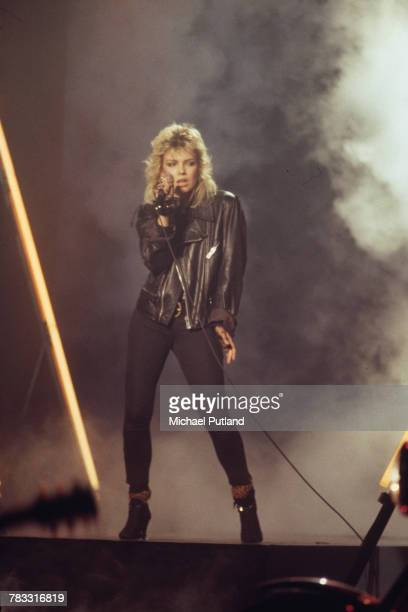 English singer Kim Wilde wearing a leather jacket performs on stage in October 1983