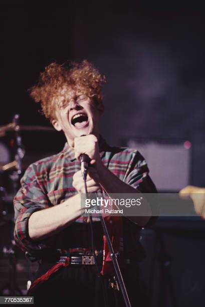 English singer Mick Hucknall performs on the set of a Simply Red video shoot in London September 1985