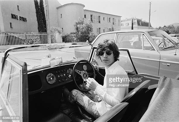 English singer Mick Jagger at the wheel of his Morgan Plus 8 Roadster outside the Hotel Byblos in SaintTropez France May 1971 He married Bianca De...