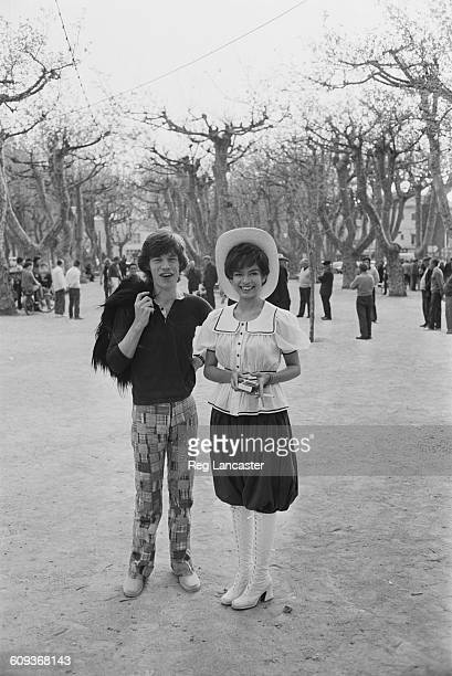 English singer Mick Jagger of The Rolling Stones with his girlfriend Bianca PérezMora Macias in St Tropez France April 1971