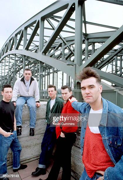English singer Morrissey with his band at the Hohenzollern Bridge in Cologne Germany during the 'Kill Uncle' tour May 1991 Left to right drummer...