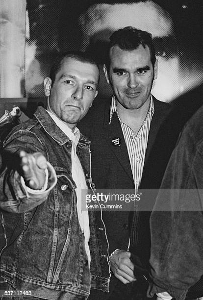 English singer Morrissey with photographer Jake Walters at a signing session for the launch of the album 'Vauxhall I' at the HMV record store London...