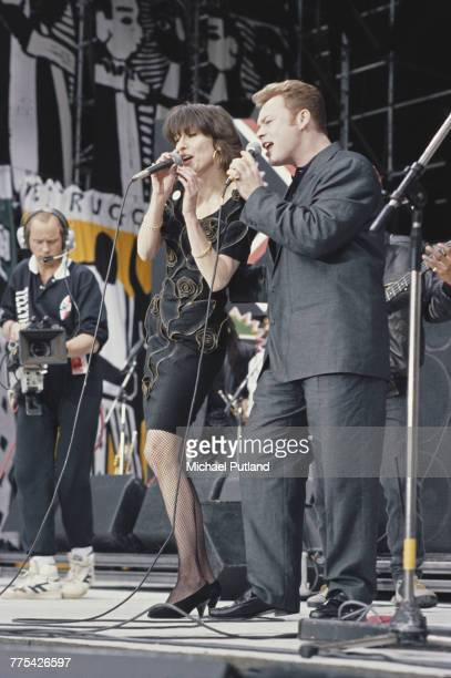 English singer musician and guitarist Ali Campbell of reggae band UB40 performs live on stage with Chrissie Hynde of The Pretenders during the Nelson...