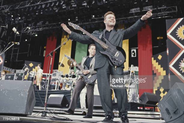 English singer musician and guitarist Ali Campbell of reggae band UB40 performs live on stage with brother Robin Campbell during the Nelson Mandela...