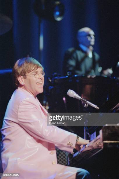 English singer musician and songwriter Elton John performs live on stage with percussionist Ray Cooper at the Royal Albert Hall in London on 12th...