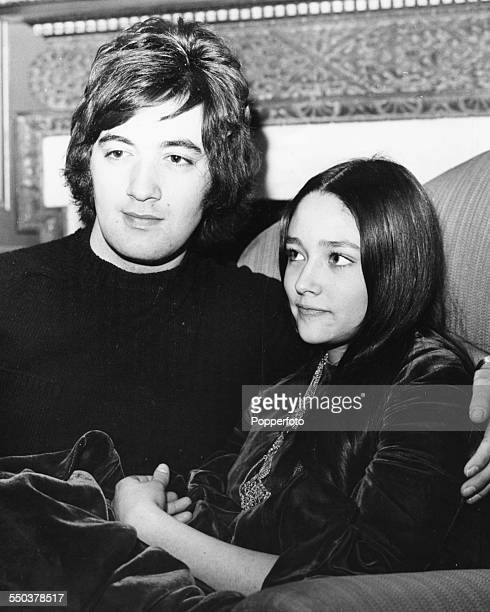 English singer Paul Ryan pictured with actress Olivia Hussey sitting together on a sofa February 5th 1969