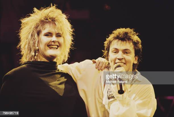 English singer Paul Young performs live on stage with guest vocalist Alison Moyet on one of two nights at Wembley Arena London 5th6th December 1985
