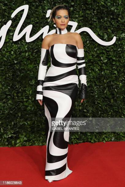 English singer Rita Ora poses on the red carpet upon arrival at The Fashion Awards 2019 in London on December 2 2019 The Fashion Awards are an annual...