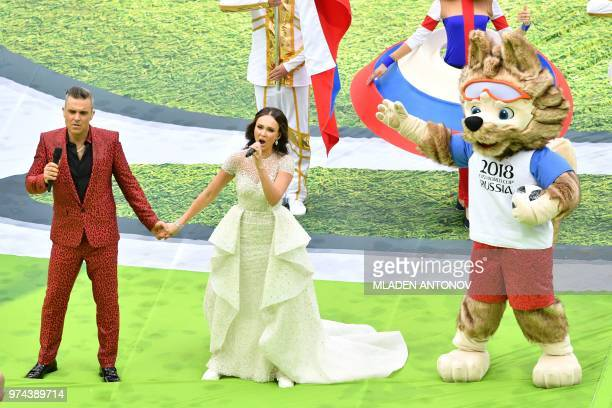 TOPSHOT English singer Robbie Williams and Russian soprano Aida Garifullina perform during the Opening Ceremony before the Russia 2018 World Cup...