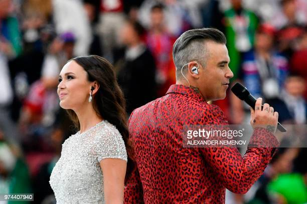 English singer Robbie Williams and Russian soprano Aida Garifullina perform during the opening ceremony before the Russia 2018 World Cup Group A...