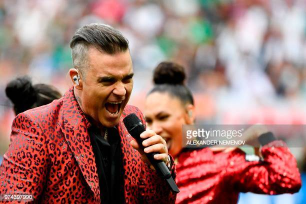 TOPSHOT English singer Robbie Williams performs during the opening ceremony before the Russia 2018 World Cup Group A football match between Russia...