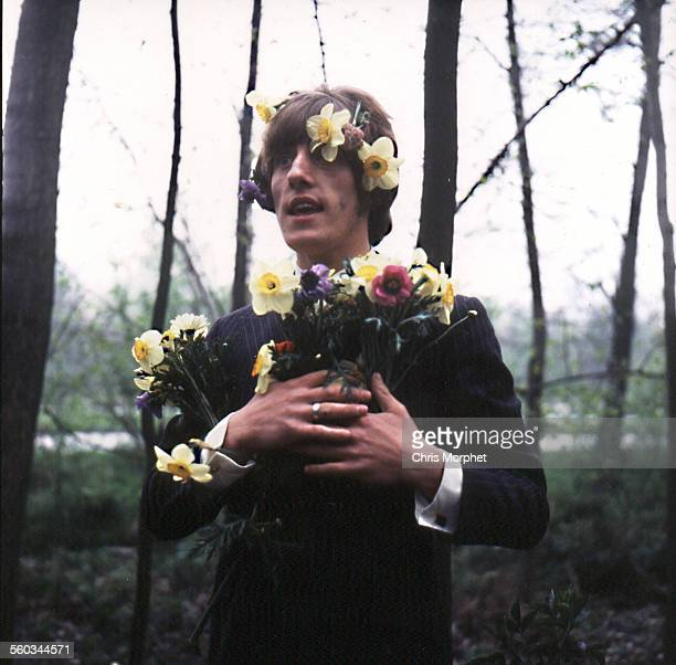 English singer Roger Daltrey of rock band The Who posing with spring flowers in his hair during a tour in Germany circa 1967