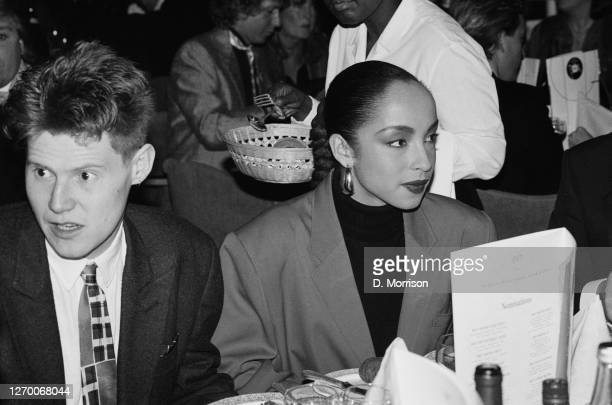 English singer Sade with her partner, English writer Robert Elms, after the British Record Industry Awards, aka the BRIT Awards, at the Grosvenor...