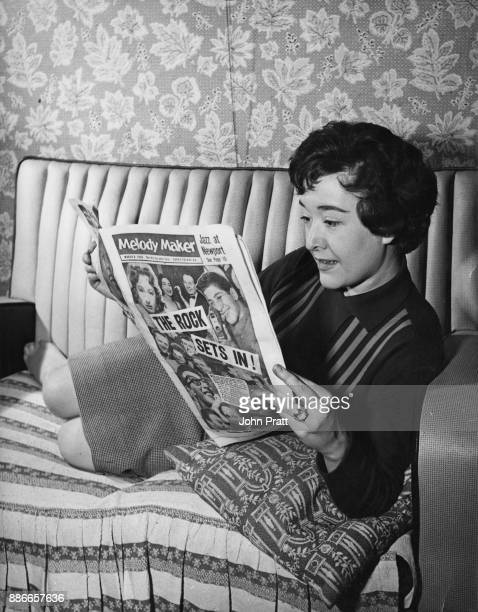 English singer Sheila Buxton reads music magazine 'Melody Maker' at home before leaving for a stage appearance UK March 1958