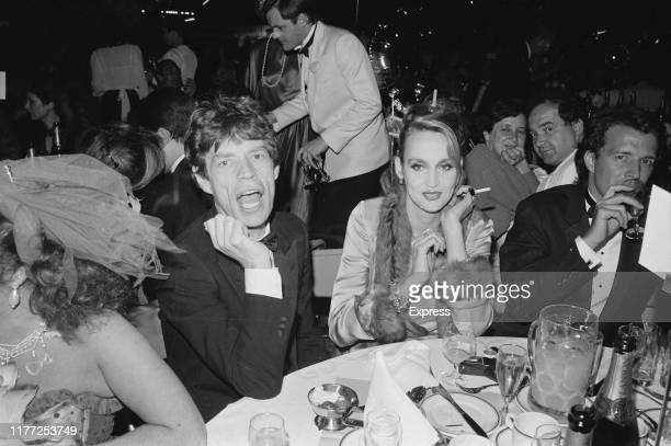 English singer, songwriter, actor, and film producer Mick Jagger and American model and actress Jerry Hall attend the Berkeley Square Ball, London,...